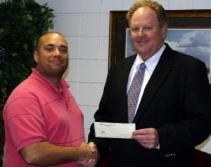 Jorge Benitez receives check from Jeffrey Murphy