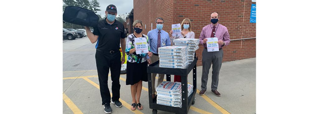 CarolinaEast receives Domino's Pizza