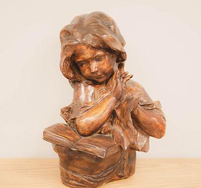 Girl reading statue
