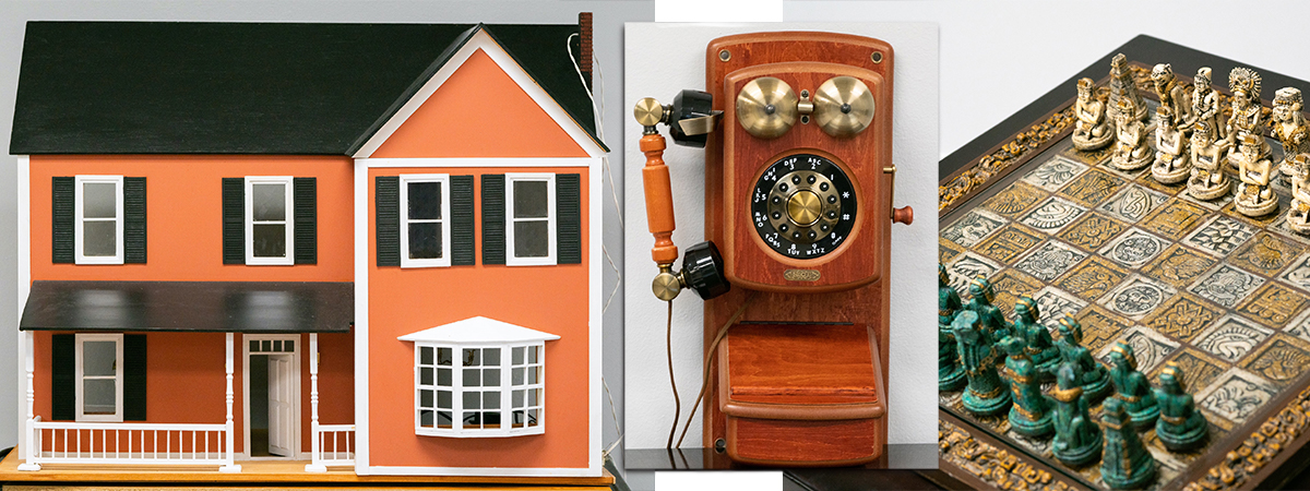 From left, a dollhouse, replica vintage phone, and Mesoamerica-themed chess set for auction.